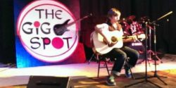 The Gig Spot Logo, guitar, rock music, band, entertainment, party, crowd, festival, drums, instruments, stage, audience, venue, event location, seating, bands, play, dancing